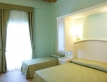 SUNSET-ROOM-CON-BALCONE-hotel-da-angelo-assisi-001-1930x800